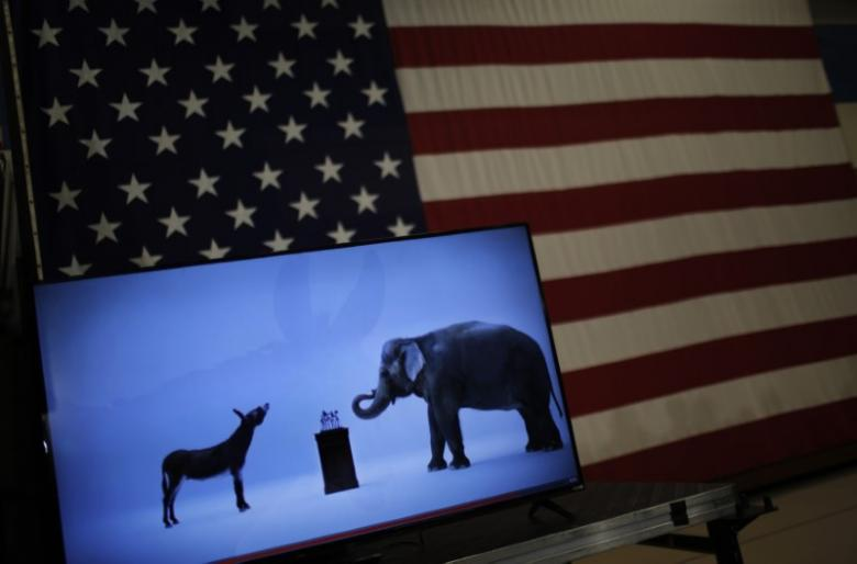 The mascots of the Democratic and Republican parties, a donkey for the Democrats and an elephant for the GOP, are seen on a video screen at Democratic U.S. presidential candidate Hillary Clinton's campaign rally in Cleveland, Ohio March 8, 2016. REUTERS/Carlos Barria