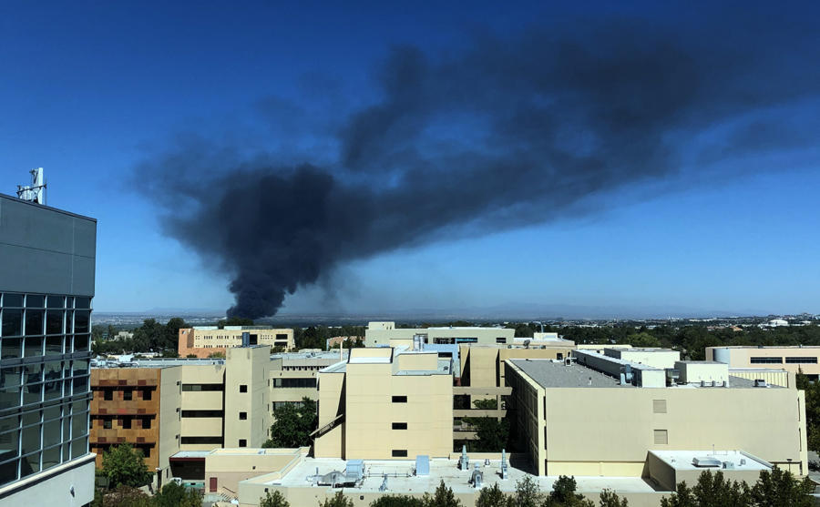 A plume of black smoke seen from the Northeast Heights rises from the fire last week at Friedman Recycling. (Eddie Moore/Albuquerque Journal)